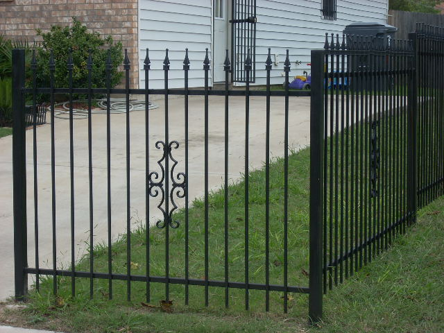 decorative iron work on fence